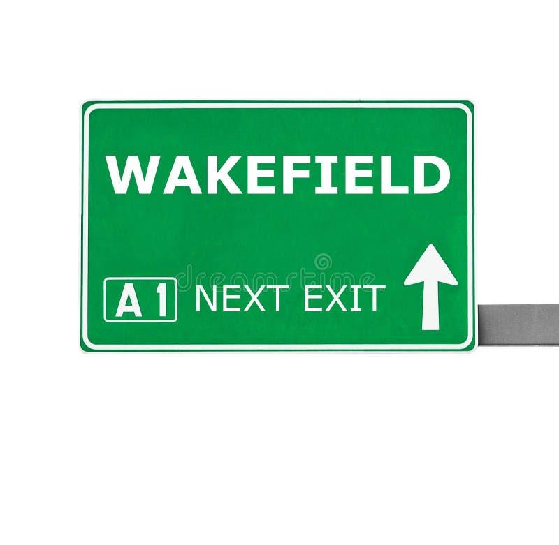 韦克费尔德在白色隔绝的路标 库存照片