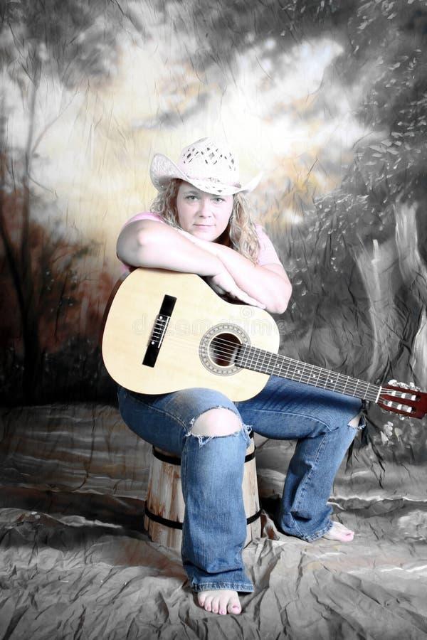 音响女牛仔吉他 库存图片