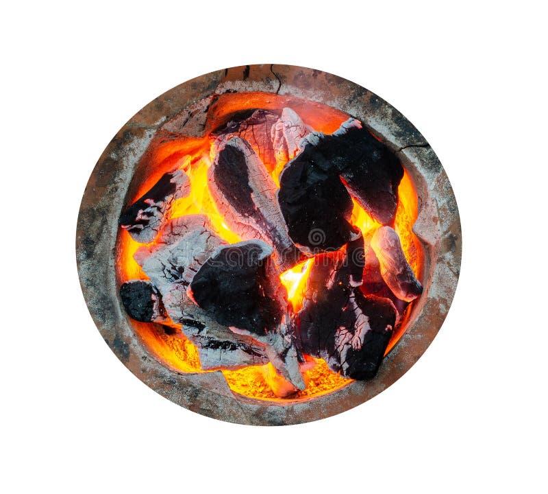 顶视图,可燃烧的木炭有火焰在格栅,被隔绝的白色背景 免版税库存图片