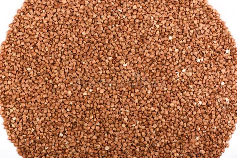 顶视图 在白色背景的荞麦 抽象背景荞麦食物纹理 免版税库存照片