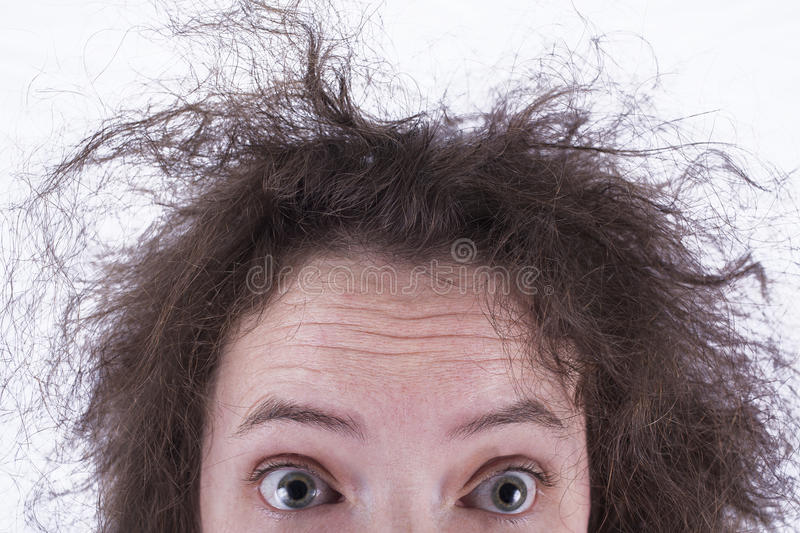 顶面一半惊奇的卷曲的头发的女孩头 图库摄影
