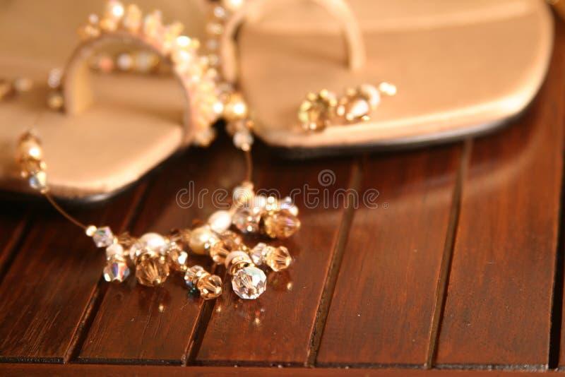 项链凉鞋 免版税库存照片