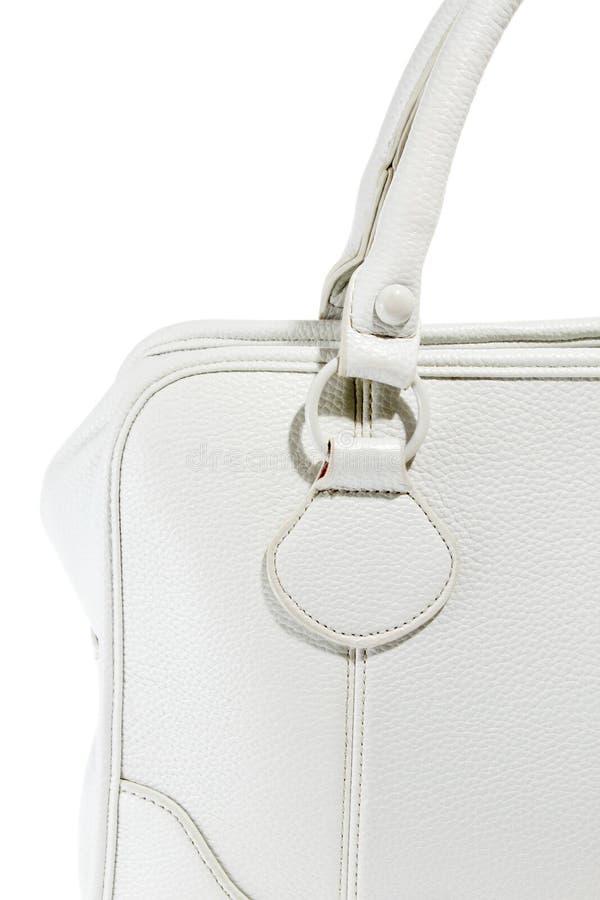 预览夫人时兴的白革提包 免版税库存图片