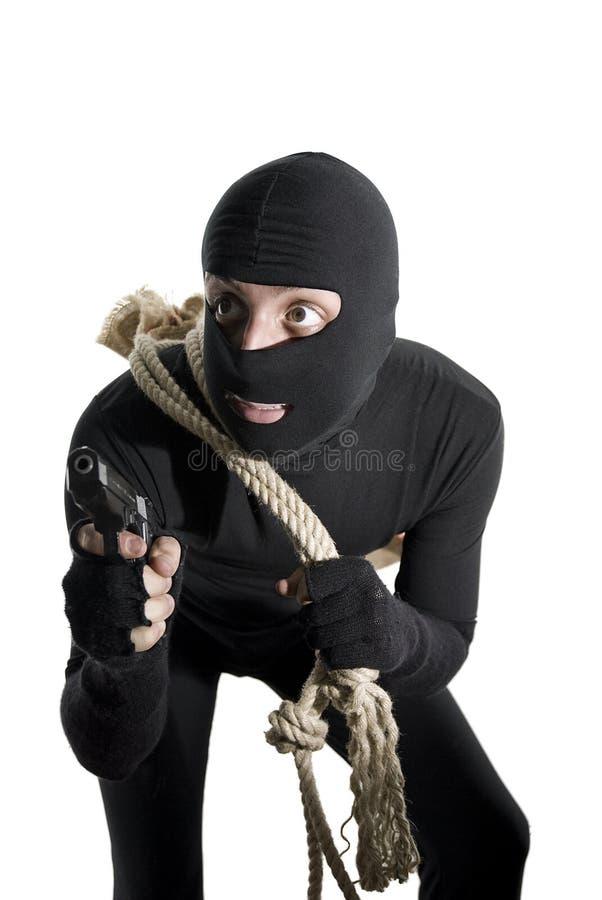预警执行他的工作准备好的窃贼 免版税库存照片