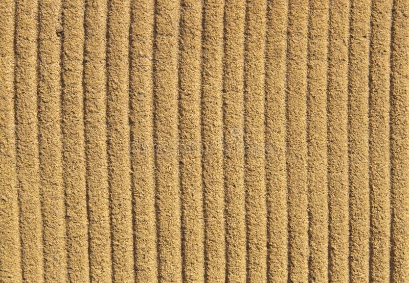 颗粒状概略的黄色墙壁结构 向量例证