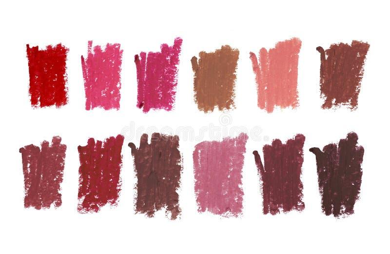 颜色嘴唇不同颜色和形状冲程样品塑造外形化妆铅笔,在白色背景隔绝的美容品 免版税库存照片