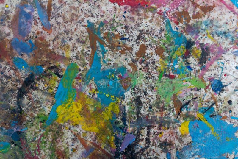 颜色多彩多姿的被弄脏的路面 背景 库存照片