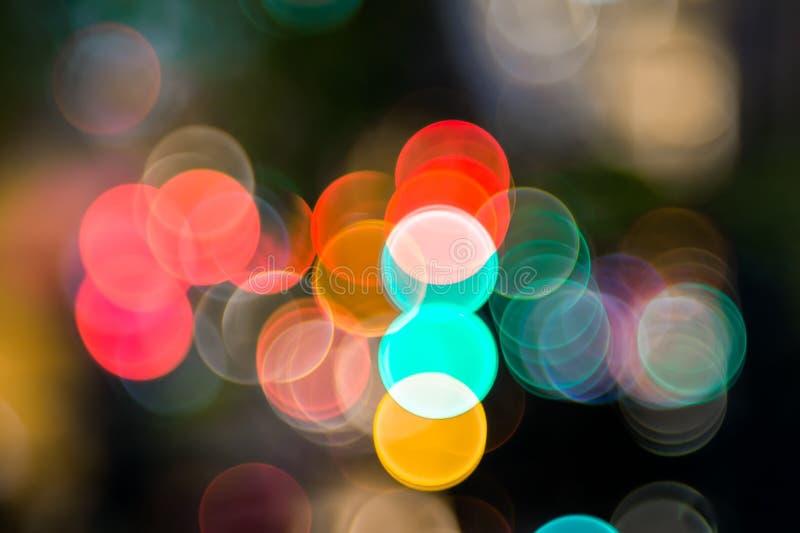 颜色夜光的Bokeh,被弄脏的背景 免版税图库摄影