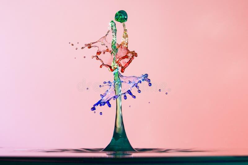 颜色水飞溅抽象背景,色的下落碰撞  库存图片