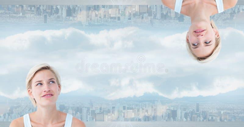 颠倒的妇女的数字式综合图象在城市 图库摄影
