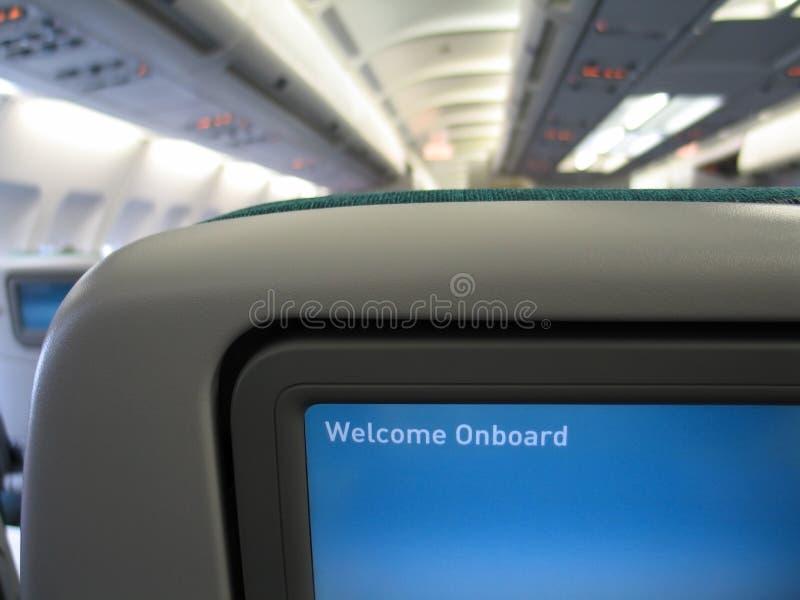 飞机内部消息屏幕欢迎 库存图片