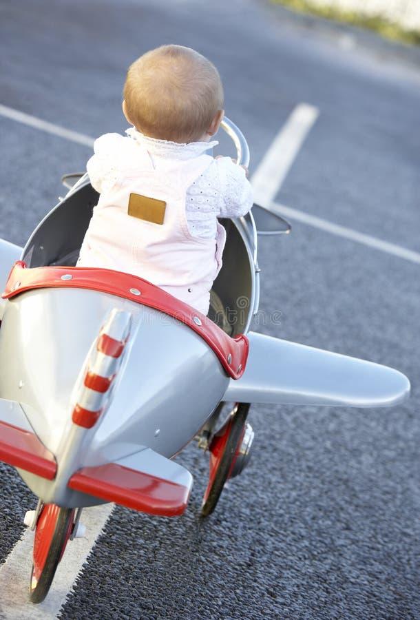 飞机女婴骑马玩具 库存照片