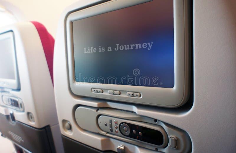 飞机座位LCD屏幕生活是旅途 免版税库存照片