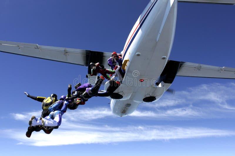 飞机落的人员 免版税库存照片