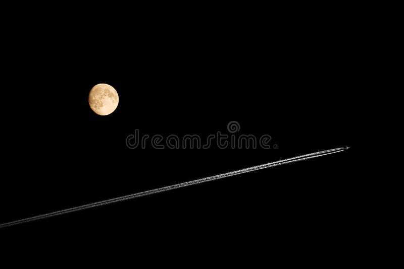 飞机黑色月亮天空 免版税库存图片