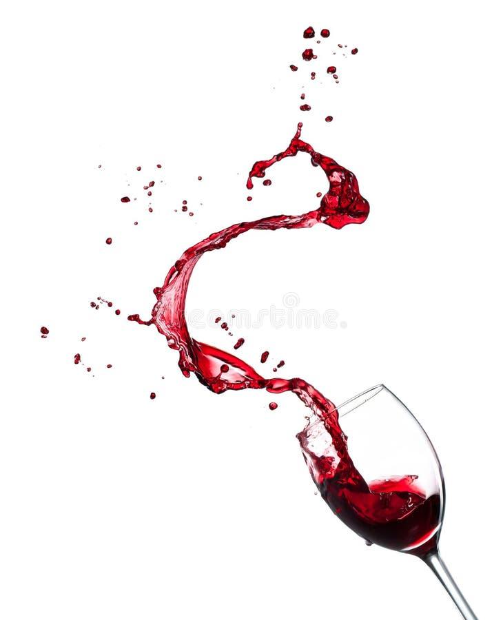 飞溅从玻璃的红葡萄酒在白色背景 库存图片