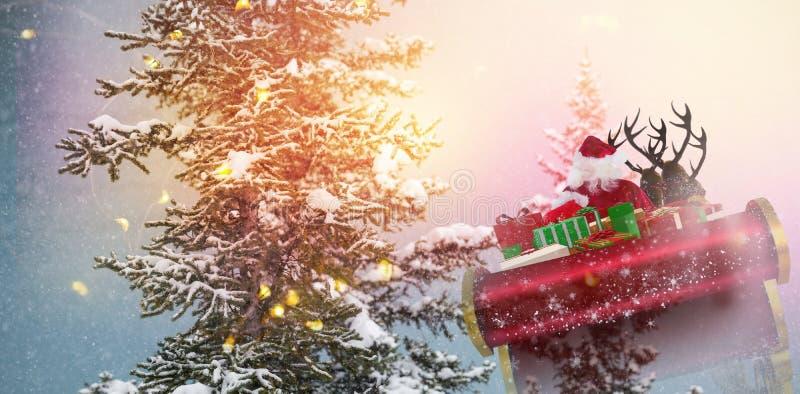 飞行他的雪橇的圣诞老人的综合图象 库存照片