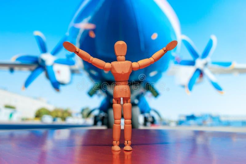 飞行员木钝汉、时装模特或者人小雕象  库存照片