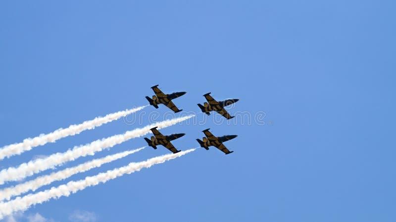 飞行在小组的四架军用飞机 库存图片