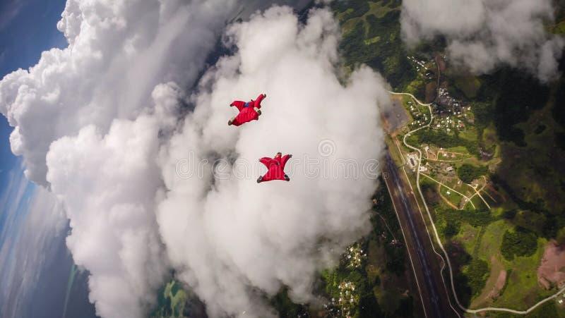 飞行在帕劳的Wingsuit 免版税库存照片