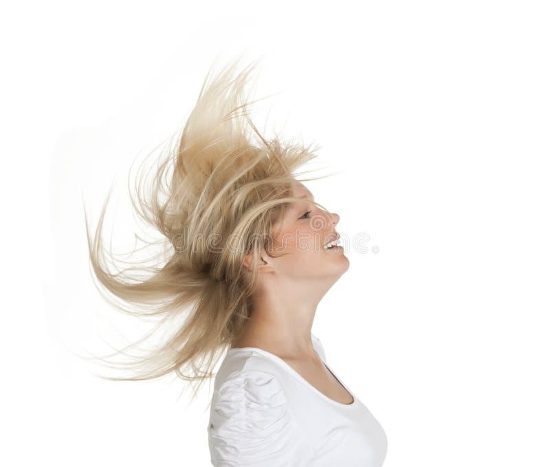 飞行头发妇女 免版税库存照片