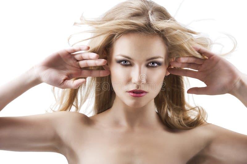 飞行头发相当肉欲的妇女 免版税库存照片