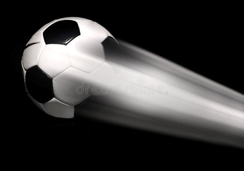飞行橄榄球足球 免版税库存照片