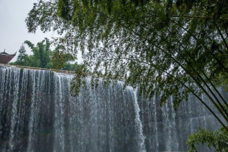 飞行瀑布在竹海域竹森林里  免版税库存图片
