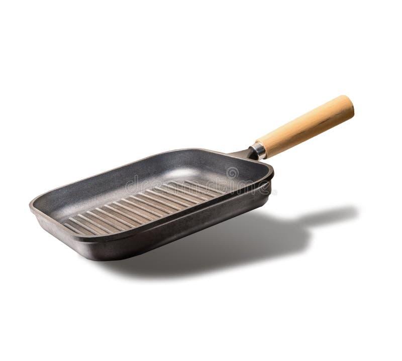 飞行的空的格栅或煎锅,隔绝在白色背景,正面图 免版税库存图片