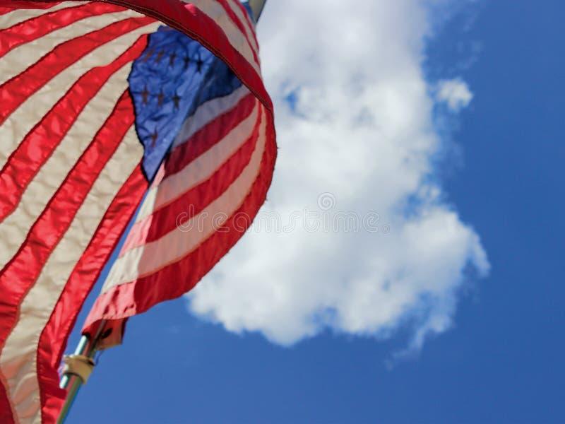 飞行的美国国旗高 库存图片