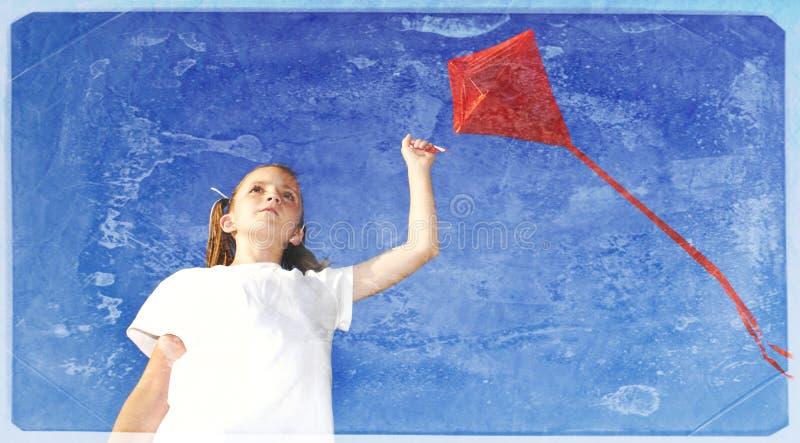飞行风筝的女孩葡萄酒照片 免版税图库摄影