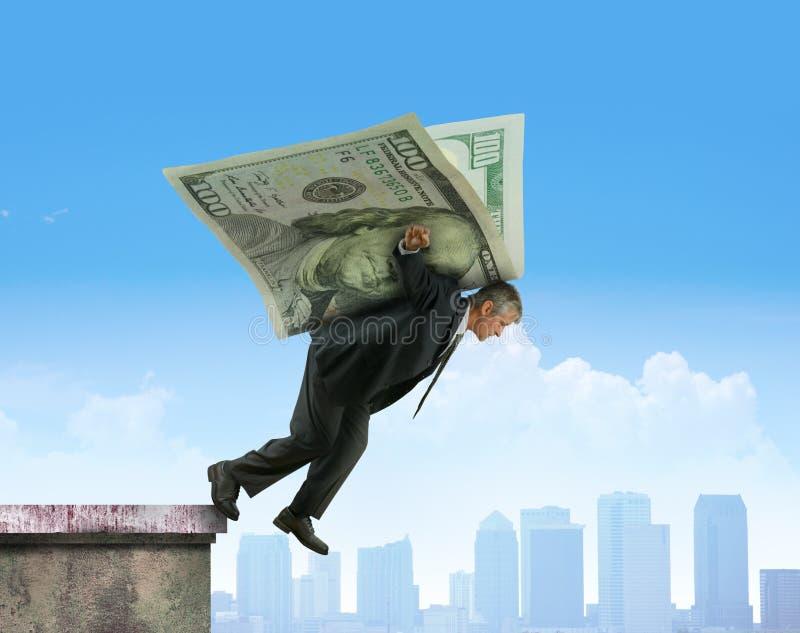 飞跃在金钱金融投资suc翼的大厦  库存图片