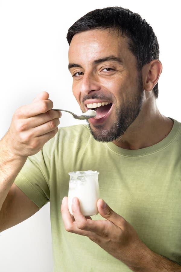 年轻食人的酸奶 图库摄影