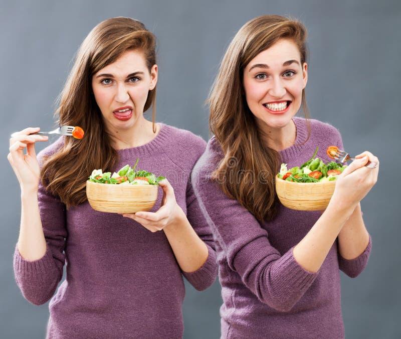 食物和饮食混乱与生气的或兴奋的少妇 库存图片