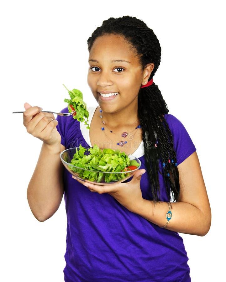 食用的女孩沙拉 图库摄影