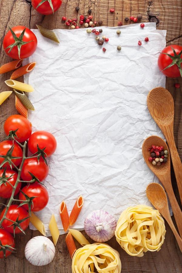 食谱的白纸用成份蕃茄面团胡椒 库存图片
