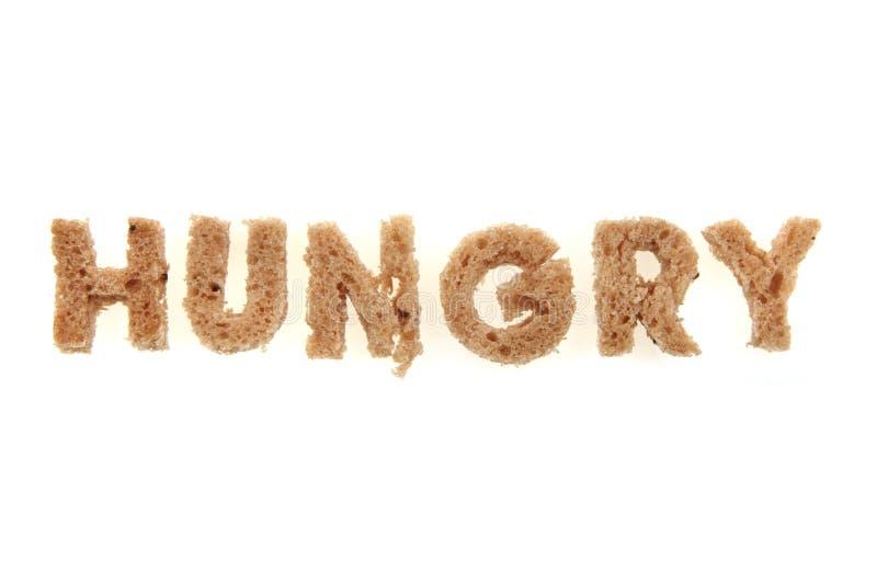 饥饿从面包字母表 图库摄影