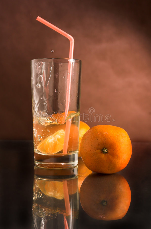 饮料玻璃蜜桔 库存照片