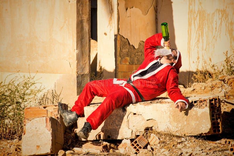 饮用的圣诞老人 库存图片