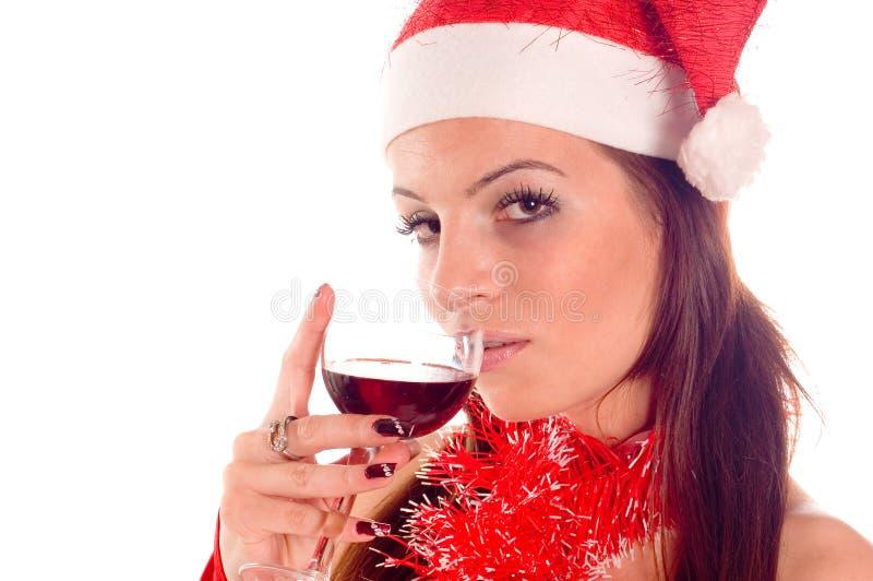 饮用的女孩圣诞老人 库存照片