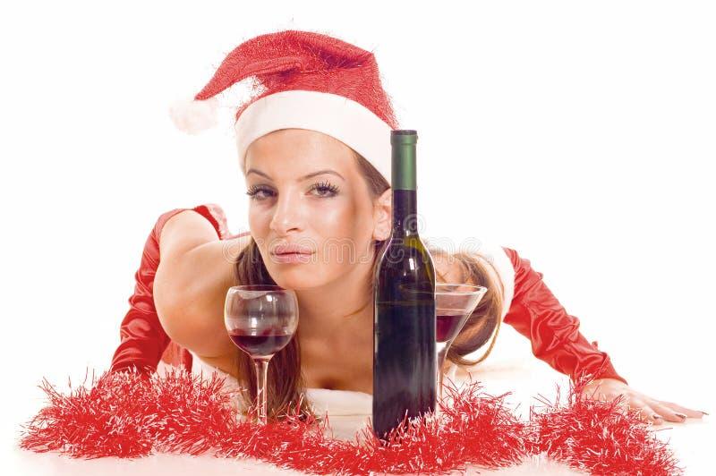饮用的女孩圣诞老人 免版税库存图片