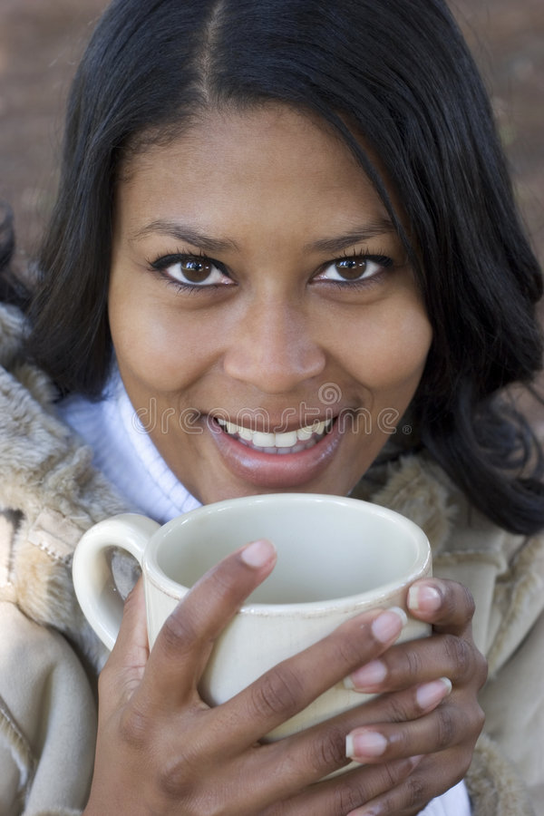 饮用的妇女 免版税库存图片