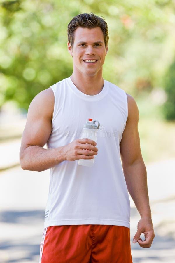 饮用的赛跑者水 库存照片