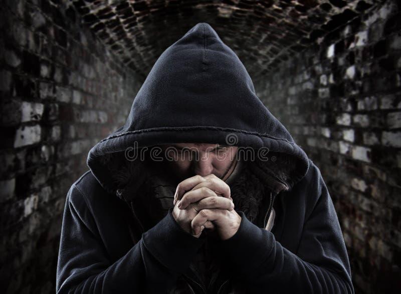 祈祷的匪盗 库存图片