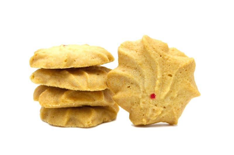 饼干用调味的牛奶、黄油和蜂蜜 堆嘎吱咬嚼的可口甜膳食和有用的曲奇饼 免版税库存照片