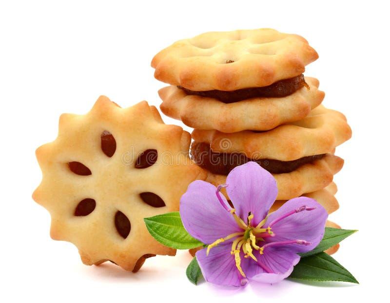 饼干,堆围绕饼干的可口麦子与一些 库存照片
