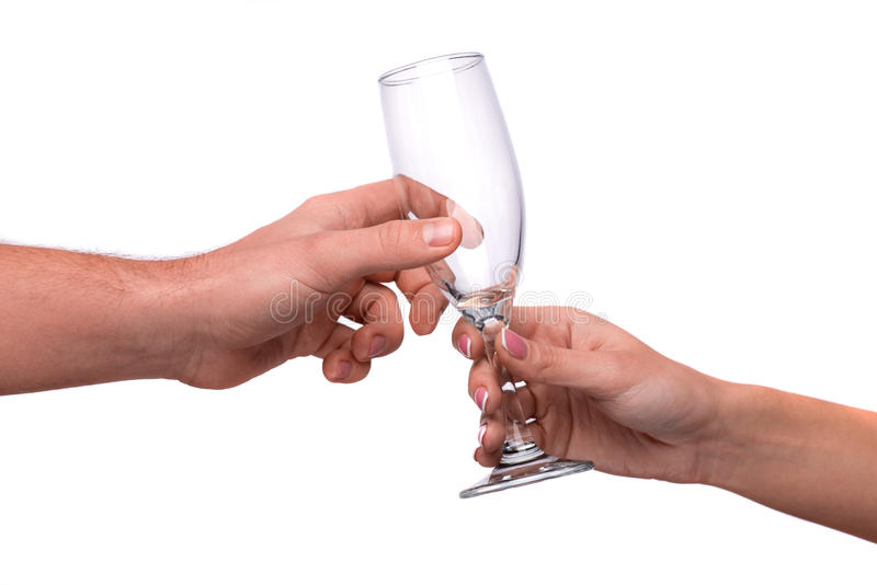给香槟槽的手 免版税库存照片