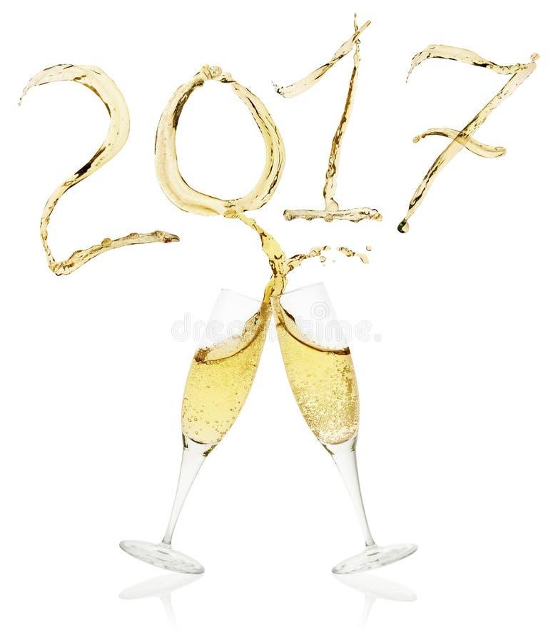 香槟飞溅2017年的杯 库存照片