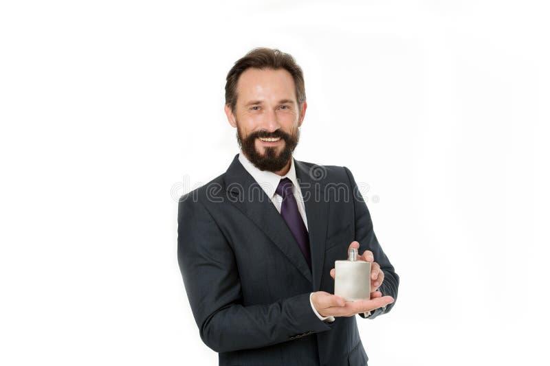 香水冠上芬芳品牌 商人经典正式衣物举行人的瓶芬芳 上司的礼物 免版税库存照片