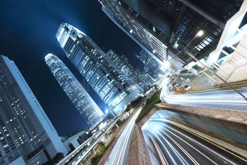 香港商业区在与轻的足迹的晚上 免版税库存照片
